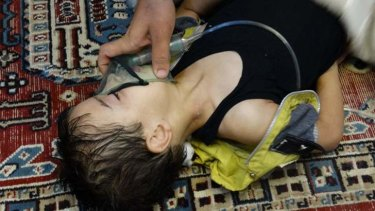 Syrian government attack: A boy, affected by what activists say is nerve gas, breathes through an oxygen mask in the Damascus suburb of Saqba.