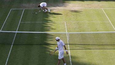 The long slog ... for America's John Isner, front, and  France's Nicolas Mahut.
