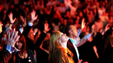 A worshipper at the Hillsong Conference, 2008 ... the Church has called in lawyers after satirical lyrics took aim at it.