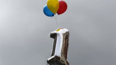 A balloon marking the first anniversary of WikiLeaks founder Julian Assange's entry to Ecuador's embassy is tethered above the building in central London June 16, 2013. Assange sought asylum in the embassy on June 19, 2012, in an attempt to avoid extradition to Sweden.
