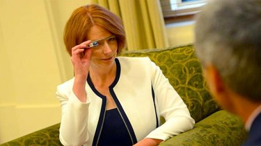 Prime Minister Julia Gillard tests out Google Glass.