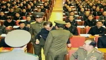 Jang Song-Thaek is dragged out of his chair during a meeting in Pyongyang.