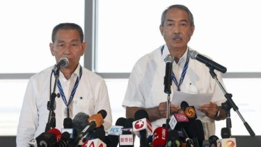 Payouts to passengers: Malaysia Airlines chief executive Ahmad Jauhari Yahya (left) and chairman Mohamed Nor Yusof speak to media.