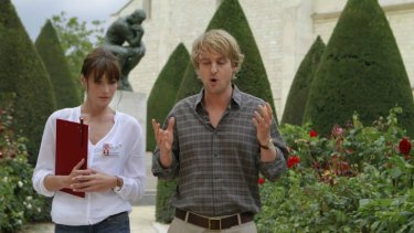 """And so my agent said..."": Carla Bruni (left) co-stars with Owen Wilson in the light Woody Allen comedy fantasy <i>Midnight in Paris</i>."