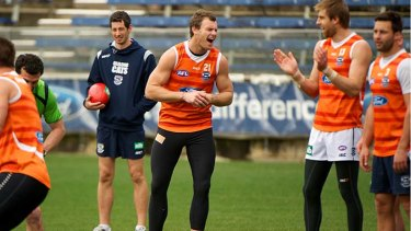 Laughs: Cameron Mooney shares a joke with Tom Lonergan and Jimmy Bartel at training as he prepares for his long-awaited return to senior football.