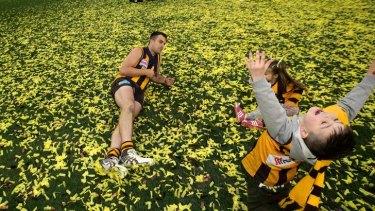 Happy days: Brian Lake and his children celebrate his brilliant grand final.