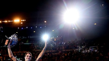 Roger Federer with the Norman Brookes Challenge Cup in his hands again.