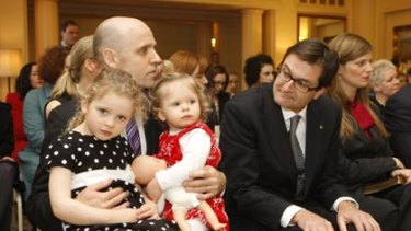 New kids on the block... Mark Arbib,  with daughters Alexandra, 3, and Charlotte, 1,  and Greg Combet wait to be sworn in.