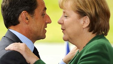 French President Nicolas Sarkozy and German Chancellor Angela Merkel head into key Greek bailout negotiations.
