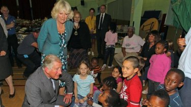 The Prince of Wales and his wife Camilla chat to children during a visit to the Tottenham Green Leisure Centre in north London.