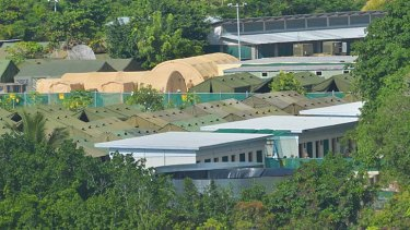 Thirteen asylum seekers have had their claims approved and been released to live on the island on temporary visas.