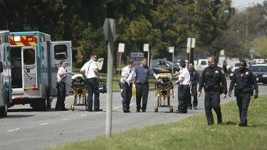 Paramedics rush stretchers to the scene.