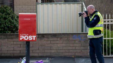 Police investigate the death of cyclist Peter McGuffie in West Footscray on Thursday.