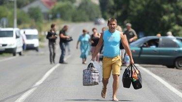 A Ukrainian flees fighting.