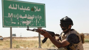 A member of the Kurdish security forces patrols the outskirts of Kirkuk.