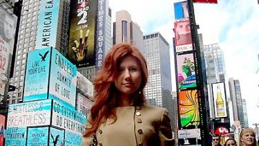 Anna Chapman, posing here in New York's Times Square, was among 10 'deep-cover' agents operating in the US.