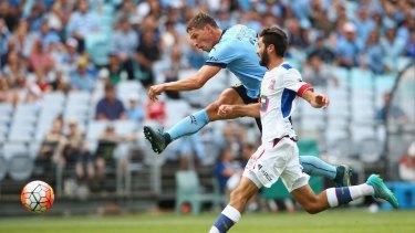 On target: Filip Holosko scores a goal under pressure from Jets defender Nicholas Cowburn.
