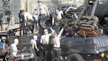 It's lunchtime: War Boys scramble over vehicles at the <i>Mad Max: Fury Road</i> show at Sydney Opera House.