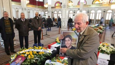 A grandfather mourns his grandson, who died along with his father after two bomb blasts killed 27 people in Damascus.