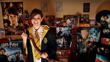 Broom to move ... Erica Crombie, a fan since she was nine, with her collection of Harry Potter memorabilia.