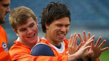 Rising Star nominee Allen  Christensen (right), with Jordan Schroeder at Geelong training yesterday.