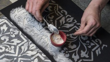 Intricate patterns: The dust in Hannah Bertram's artwork is applied using hand-cut stencils.