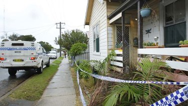 Murder mystery: police cordoned off Anthony O'Grady's home.