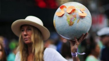 A woman takes part in a march against climate change in New York on Sunday.