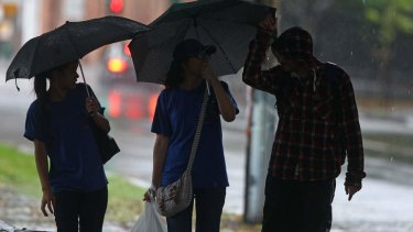 Staying dry ... torrential rain hit Sydney on Monday.