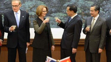 Prime Minister Julia Gillard shares a toast with Chinese Premier Li Keqiang during a signing ceremony at the Great Hall of the People in Beijing on April 9.