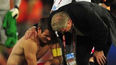 Gutted .... New Zealand skipper Ryan Nelsen, left, is comforted by coach Ricki Herbert