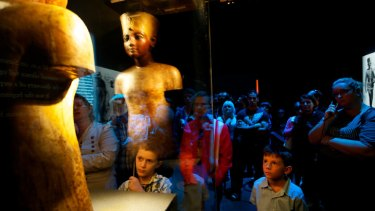 Children among  the huge crowd flocking to Melbourne Museum's <i>Tutankhamun and the Golden Age of the Pharaohs</i> exhibition are fascinated by Ancient Egypt's Boy King.