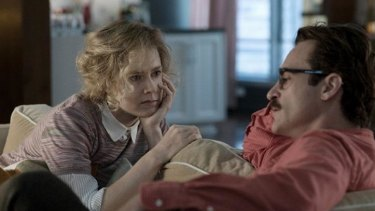 Amy Adams as Amy and Joaquin Phoenix as Theodore in the romantic <i>drama Her</i>.