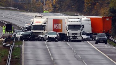 Emergency crews have been unable to confirm the cause of a multiple-car pile-up near Taunton in England.