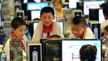 Chinese children attend a computer class to learn how to properly use the Internet, in Beijing.