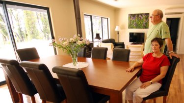 Ian and Julie Gilroy-Scott, who lost their house a year ago in the bushfires, in their new home in Callignee.