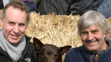 <i>Red Dog</i> star Koko gets cosy with producer Nelson Woss (left) and trainer Luke Hura.