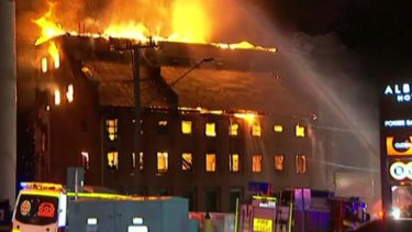 The historic Albion flour mill in flames on Wednesday morning.