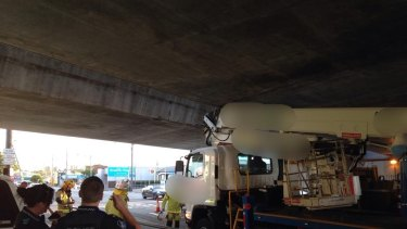 Queensland Rail has warned drivers to check vehicle heights after a rail bridge crash at Woolloongabba