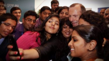 Prime Minister Tony Abbott mixes with students.