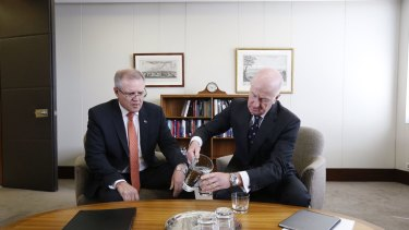 Glass half-full? RBA governor Glenn Stevens, right, and Treasurer Scott Morrison.