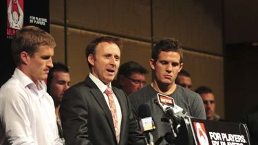 (From left to right) Luke Power, Matt Finnis and Luke Ball representing the AFL Players' Association earlier this year.