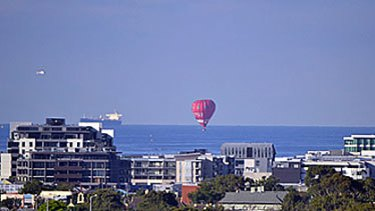 The hot air ballon over Port Melbourne this morning.