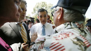 US Republican presidential candidate Senator Ted Cruz talks with a supporter.