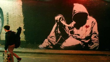 Banksy's artwork and base jumps are very public actions, unlike the works of cyber outlaws.