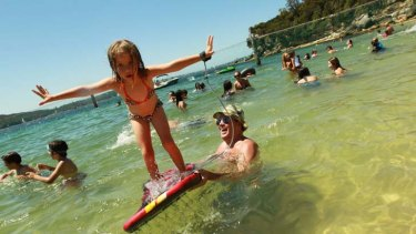Up and away ... Craig Gill and his daughter Petal, 5, take to the water at Nielson Park yesterday as the temperature rose.