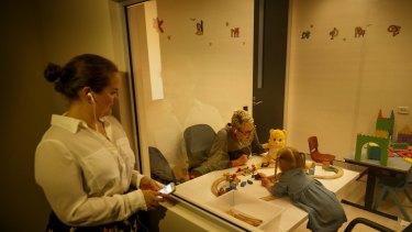 FACS psychologist Jessica Warren watches through a one-way mirror for PCIT.