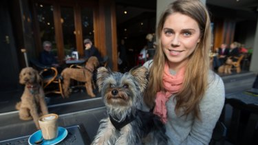 Kat Gaylard and her dog, Harvey Howard, enjoy a visit to a cafe in South Yarra.