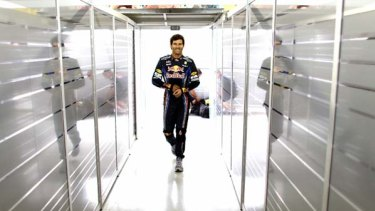 Still confident ... Mark Webber enters the garage in Brazil during the week. He is trailing championship leader Fernando Alonso by just 11 points with two races to go.
