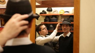 Suits you, sir ... milliner Robert Carroll from Strand Hatters with some of the hats men are buying.